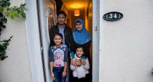 "Mohammad Rafique, his wife Rafika Begum and their children Jamalida (8) and Waheeda (4) at their home in Carlow. ""We never enjoyed citizenship but today my girls are Irish and have rights as citizens."" Photograph: Brenda Fitzsimons"