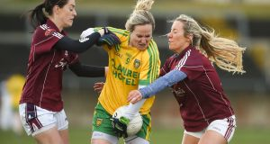 Donegal's Karen Gutherie comes under pressure from Galway duo Emer Flaherty and Megan Glynn during Donegal's away victory.  Photograph: Diarmuid Greene/Sportsfile