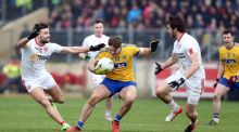Ultan Harney of Roscommon with Tiernan McCann and Ronan McNamee of Tyrone. Photograph: Andrew Paton/Inpho
