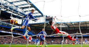 Chelsea's Marcos Alonso scores at Stamford Bridge on Saturday, heading into the net after he elbowed Arsenal's Héctor Bellerín in the jaw as the two players vied for a loose ball. Photograph: Clive Rose/Getty Images