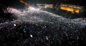 Tens of thousands of people gather for a demonstration in from of the government building in Bucharest, Romania on Sunday. Photograph: Darko Bandic/AP