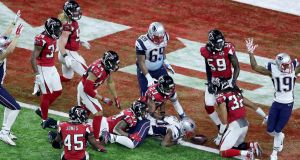 The New England Patriots score the winning touchdown against the Atlanta Falcons at Sunday's Super Bowl in Houston, Texas. A 30-second TV ad slot for the game cost $5 million. Photograph: Andrew Gombert/PA