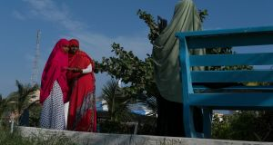Girls pose for a photo in the Peace Garden, a park that opened in the last few years in Mogadishu. Photograph: Tyler Hicks/New York Times