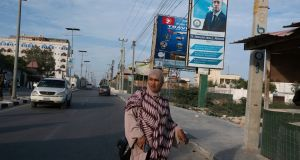 An election billboard along a street in Mogadishu. The election billboards carry promises of good government that the public puts little faith in. Photograph: Tyler Hicks/New York Times