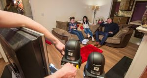Gogglebox Ireland: Danielle, Laura and Des Grufferty in front of the tiny cameras. Photograph: Brenda Fitzsimons