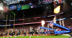 The New England Patriots  take to the field   before the start of Super Bowl LI: Lady Gaga's half-time performance drew 117.5 million viewers. Photograph: Tannen Maury/EPA