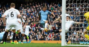 Manchester City striker Gabriel Jesus scoring the opening goal against Swansea City during his side's 2-1 victory at the Etihad Stadium.   Photograph: Stu Forster/Getty Images