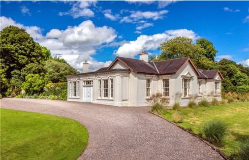 Savills is seeking €1.85 million for this six-bed house and two-bed gate lodge at Dunsland, Glanmire, Co Cork on 52 acres