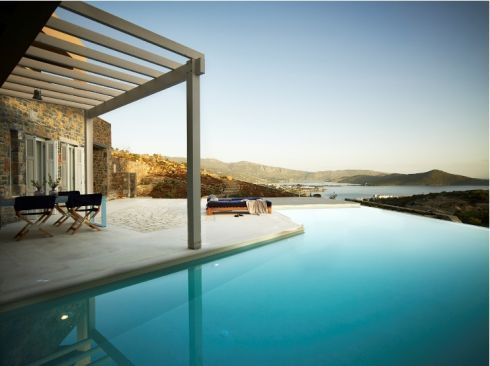 <b>Greece: Crete</b> <br><br>On the north of the island near the fishing village of Elounda, this four-bed villa measuring 265sq m (2,852sq ft) looks out to the sea and has its own swimming pool. All of the bedrooms have sea views and three have terraces. The kitchen and diningrooms open on to a dining area by the pool. <br>Price: €1,900,000 <br>Agent: demeuresdegrece.com