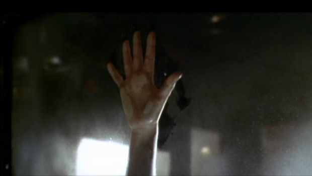 The hand of Kate Winslet on the car window in Titanic