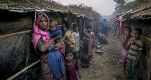 People stand outside their shelters in Kutapalong Rohingya refugee camp on February 8th, 2017 in Cox's Bazar, Bangladesh.  Photograph: Allison Joyce/Getty Images