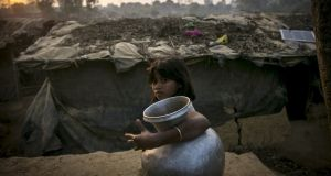 A girl carries a water jug in Kutapalong Rohingya refugee camp on February 8th, 2017 in Cox's Bazar, Bangladesh. The United Nations estimates about 69,000 Rohingya Muslims have fled to Bangladesh from Myanmar since October last year after the Burmese army launched a campaign it calls 'clearance operations' in response to an attack on border police. Photograph: Allison Joyce/Getty Images