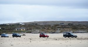 The remains of Pascal Whelan are brought across the sands at low tide to Omey Island in Connemara for burial following funeral mass in nearby Star of the Sea Church in Claddaghduff, Co Galway. Photograph: Bryan O'Brien