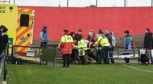 A  St Munchin's College player is taken to an ambulance after being injured in the Munster Schools Junior Cup quarter-final against Presentation Brothers College Cork at Musgrave Park on Wednesday. Photograph: Larry Cummins