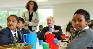 'Britain's toughest teacher' Katharine Birbalsingh at the Michaela Community School in north-west London during a visit by former London mayor Boris Johnson. The school has been dubbed 'the strictest school in Britain'.