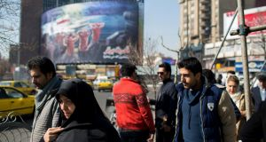 Valiasr Square in Tehran, with a huge mural of captured US navy sailors in the background. Gloom and even dread can be felt across the city, where some blame not only the Trump administration but also their own leaders for the possibility of a violent conflict between Iran and the US. Photograph: Arash Khamooshi/The New York Times