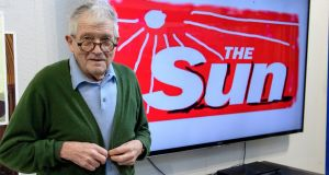 "David Hockney with his redesigned masthead for a one-off edition of the Sun newspaper. The artist gave qualified approval for Brexit: ""The power has spread to the people because that's what the iPhone has done."" Photograph: Arthur Edwards/The Sun/PA Wire"