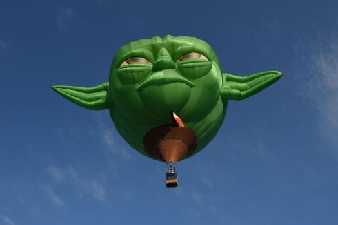 AIR FORCE: A hot air balloon shaped like 'Star Wars' character Yoda takes flight during the International Hot Air Balloon Festival in the Philippines. Photograph: Ted Aljibe/AFP/Getty Images