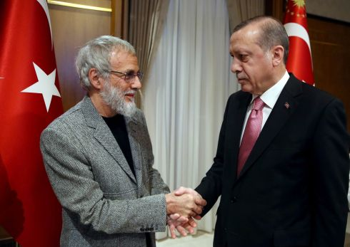 SING PRAISES: British singer Yusuf Islam, formerly known as Cat Stevens, shakes hands with Turkish president Recep Tayyip Erdogan, in Ankara. Photograph: Yasin Bulbul/AFP/Getty Images