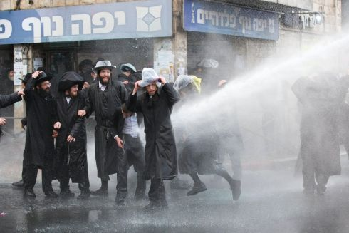 ISRAELI PROTEST: Israeli police use a water cannon to disperse ultra-Orthodox Jewish demonstrators during a protest against army recruitment in Jerusalem. Photograph: Abir Sultan/EPA
