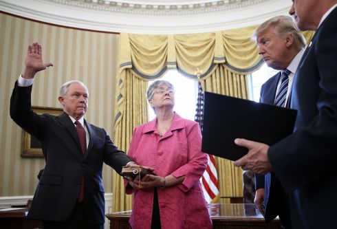 US POLITICS: US president Donald Trump watches as Jeff Sessions is sworn in as the new US attorney-general, in the White House in Washington, DC. Photograph: Win McNamee/Getty Images