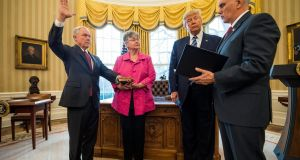 US vice-president Mike Pence swears in attorney general Jeff Sessions while Sessions's wife, Mary and US president Donald look on in the Oval Office of the White House. Photograph: Jim Lo Scalzo/EPA