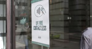 A 'We Are Contactless' sign at a Wasabi sushi restaurant in London. Photograph: Simon Dawson/Bloomberg via Getty Images