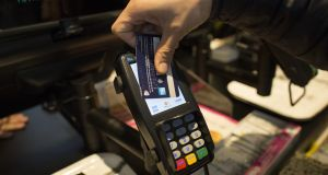 A contactless payment by credit card on a Verifone Systems Inc payment device in London. Photograph: Simon Dawson/Bloomberg via Getty Images