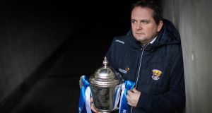 Wexford manager Davy Fitzgerald, with the league trophy he won with Clare last year, in Croke Park this week.  Photograph: Ryan Byrne/inpho