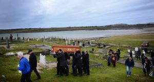 The remains of Pascal Whelan are brought across the sands at low tide to Omey Island in Connemara for burial following funeral Mass in nearby Star of the Sea Church in Claddaghduff, Co Galway. Photograph: Bryan O'Brien/The Irish Times