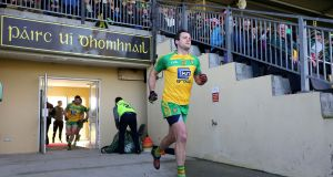 Michael Murphy leads out his team last week: After the Kerry defeat, Donegal will be eager to get off the mark against Roscommon on Sunday. Photograph: Lorcan Doherty