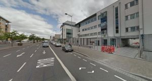 A man in his late teens was arrested and detained at Ballymun Garda station (above right) under provisions of Section 4, the Criminal Justice Act. File photograph: Google Street View
