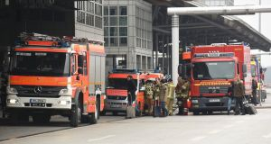 Firemen at Helmut Schmidt airport in Hamburg, Germany, on Sunday. The airport has reopened after an unknown substance had been  found in the security check area. Photograph: Fabian Bimmer/Reuters