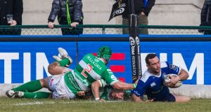 Leinster winger  Dave Kearney scores one of his two tries in the Guinness Pro 12 game against  Benetton Treviso at Stadio Monigo. Photograph: Alfio Guarise/Inpho