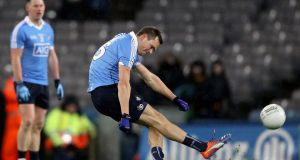 Dublin's Dean Rock kicks a point to level the game against Tyrone. Photograph: Tommy Dickson/Inpho