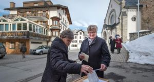 Swiss voters have their say on such issues as immigration and tax reform. Photograph: Benjamin Manser/Keystone/AP