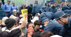 The Japanese government resumed work on the Okinawa island base on February 6th, sparking angry protests and scuffles with police. Photograph: Jiji Press/AFP/Getty Images