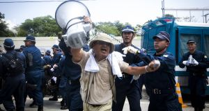 "Protest leader Hiroji Yamashiro. Law professor Lawrence Repeta   calls his repeat arrests ""a shocking display of raw government power"". Photograph: Richard Atrero de Guzman/NurPhoto via Getty Images"