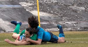 Hannah Tyrrell scores Ireland's  bonus-point try in the 81st minute in Italy. Photograph: Giuseppe Fama/Inpho