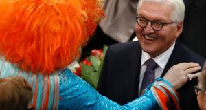 New German president Frank-Walter Steinmeier is congratulated by  drag Queen Olivia Jones after the election. Germany's former foreign minister is in the centre-left Social Democrats party. Photograph: Odd Andersen/AFP/Getty Images
