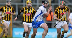 Waterford's Pauric Mahony keeps one step ahead of Kilkenny challengers. Photograph: Ken Sutton/Inpho