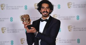 British actor Dev Patel poses with the award for a Supporting Actor for his work on the film Lion. Photograph: Getty Images