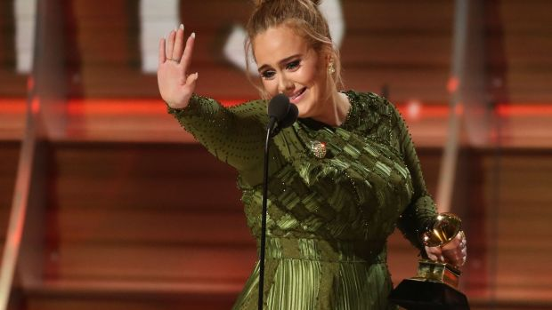 Adele waves to singer Beyoncé who is in the audience at the Grammys in Los Angeles. Photograph: Lucy Nicholson/Reuters