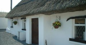 This traditional whitewashed thatched Irish cottage was built in 1790.