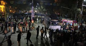 Police and security officers cordon off the area of a deadly bombing, in Lahore, Pakistan. Photograph: KM Chaudhry/AP Photo
