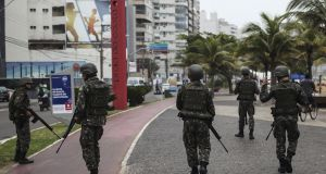 Soldiers patrol the streets of Vitória, Espírito Santo, Brazil on Thursday: residents locked themselves in their homes as violence swept through the city after police went on strike. Photograph: Antonio Lacerda/EPA