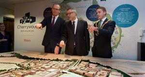 Minister for Finance Simon Coveney, with Brian Moran of Hines Ireland and cathaoirleach Cormac Devlin, at the launch of building plans at Cherrywood, Co Dublin. Photograph: Cyril Byrne