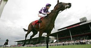 Johnny Murtagh wins the Dubai Duty Free Irish Derby on Fame and Glory in 2009. Photograph: Morgan Treacy/Inpho
