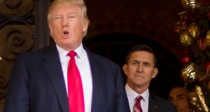 Donald Trump with his former security adviser Michael Flynn (right). Photograph: Jim Watson/AFP/Getty Images