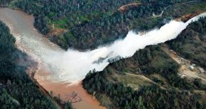 Water continues to run down the main spillway at Lake Oroville on Monday. Photograph: Randy Pench/AP